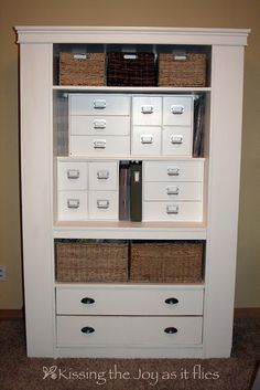 Repurposed ... from an entertainment center to a craft center.....didnt think about using Michaels craft cubes in the large opening!