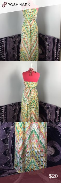 """Forever 21 Chiffon Maxi Dress This super cute Maxi dress has a Polyester slip under a beautifully patterned chiffon like outer. Backless top ties behind the neck to add to your fresh summer look! Super small snag in material at the very bottom of the dress, you can only see it if you are looking hard for it. Please see last picture. Measures 50"""" in length to the top of the chest then each string/strap is 27"""" so you can adjust. Chest is 15"""" waist is 12"""" waist is elastic so it stretches…"""