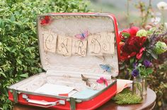 Cards in vintage suitcase. *I'm definitely doing this... I have a light blue suitcase just like that!