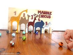 DIY marble circus game - good for rolling for the kids that can't throw. Older kids could flick with their fingers