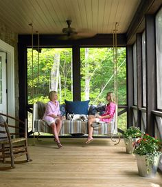 Love this porch's swing? It's actually a custom swinging daybed - perfect for overnight guests seeking a place to sleep.