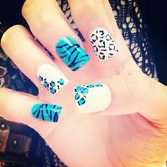 Blue, white and teal animal print nails.  Includes zebra/tiger print and leopard/cheetah print.