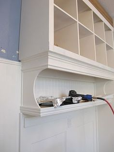 Take 2 bookshelf's and turn it into a organized mudroom wall