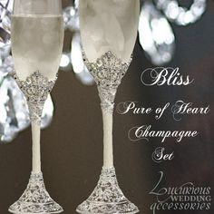 """The Bliss Pure of Heart Champagne Flutes from Luxurious Wedding Accessories are absolutely beautiful. Made with hand-set clear Swarovski Crystals and white hand enameling on an intricate filigree silver tone metal design.  Sold as a Set of 2 Champagne Glasses. Sized: 2.5"""" Dia. x 10.5""""High  Available in White or Black Enamel.  #timelesstreasure"""