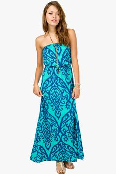 Get swept away in a bold printed maxi dress. This strapless maxi has a blouson top with an abstract tribal print.