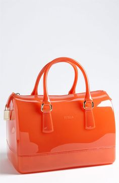 It rains a lot where I live so for some reason this bag really appeals to me. It is even large enough to stuff what ever other bag I may be carrying inside. Is that an obsession I would buy a $248 bag to stuff my $495 Tory inside when it's raining?   Furla 'Candy' Transparent Rubber Satchel available at #Nordstrom