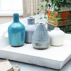 Coastal shades of blues and white give these terra cotta vases a Mediterranean character. Petite and stout, the vases look great as-is or filled with short buds.  Find the Coastal Terra Cotta Vases - Set of 4, as seen in the Best of Boho Sale Collection at http://dotandbo.com/collections/black-friday-style-sale-boho?utm_source=pinterest&utm_medium=organic&db_sku=CCO0226