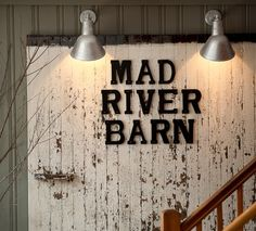 The Old Barn Door Serves as the Sign in the Lobby. www.madriverbarn.com