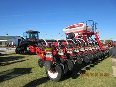 16 row White 8800 corn planter behind black Challenger MT775E X Edition tractor