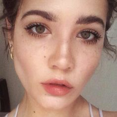 BB cream, nude eyeshadow, and a peachy lip for a natural look