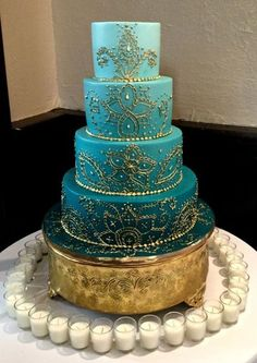 Gold Wedding Cakes Blue ombre Indian wedding cake with gold mehndi designs and a gold base makes for a modern but elegant Indian wedding cake Indian Cake, Indian Wedding Cakes, Cool Wedding Cakes, Beautiful Wedding Cakes, Wedding Cake Designs, Beautiful Cakes, Amazing Cakes, Quirky Wedding, Trendy Wedding