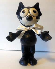1920's Felix the Cat wood composite doll estimate value $650 on Ebay?  We will see how much I can get for this antique toy