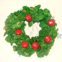 Cookies for Santa ~Holly Christmas Cookies Let the kids get sticky and have fun with these little sweet holly wreath cookies. Christmas Deserts, Holly Christmas, Christmas Goodies, Christmas Baking, Christmas Items, Holiday Baking, Christmas Wreath Cookies, Xmas Wreaths, Holly Wreath
