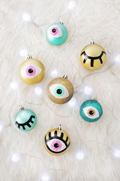 I've been browsing different holiday catalogs and websites over the past month to gather some Christmas DIY inspiration for this year, and something caught my eye—more eyes! Well, ornaments decorated