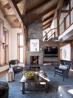 This great room boasts a high volume ceiling with contemporary framing and minimalist cable-rail balcony. This house was designed and built by Bensonwood, out of Walpole, New Hampshire. Photography is by James R. Mix Use Building, Building Systems, Reclaimed Wood Paneling, Accent Colors For Gray, Beam Structure, Prefab Buildings, Modern Prefab Homes, Timber Frame Homes, Hall Design