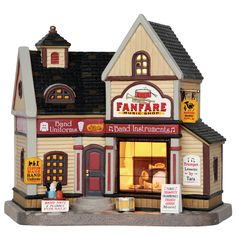 Lemax Fanfare Music Shop SKU# 65128 Released in 2016 as a Lighted Building for the Caddington Collection.