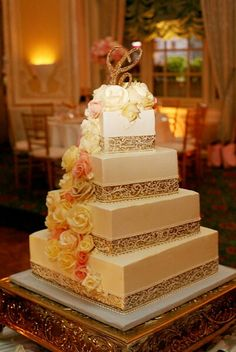Beautiful wedding cake in gold tones with a gold crystal monogram wedding cake topper. -repinned by wedding specialists http://dazzlemeelegant.com