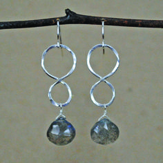 These earrings have a unique juxtaposition of organic and geometric lines with the use of the soft figure 8 shape an the teardrop stone. Also, both stone options are great colors that are pretty without being overpowering, so they can still be worn with the majority of your wardrobe. Materials:Sterling silver and labradorite or prehnite stonesPlease contact me if you would prefer a different stone.
