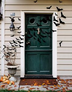 Watch out for the flock of bats outside! Get our free template to make these for your front door.
