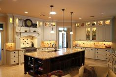 Love the dark lower cabinets combined with the light uppers...
