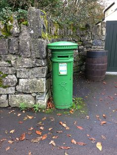 Irish post box from British rule times painted green since independence at Bunratty Co. Clare