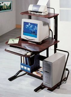 New Computer Desk With Printer Stand with Mahogany Finish by The Green Group. $119.99. Top Shelf for Wide Format Printers / Slide-out Keyboard Shelf. Integrated CD Rack Holds 26 CD Jewel Cases / Scuff Resistant Mahogany PVC Finish. Rear Hooded Double Wheel Locking Casters. Adjustable Tilt/Flat Monitor Bay Fits Screens Up to 21 Inches. Large Workshelf Keeps Papers Out of the Way. This computer desk, while modern and stylish, is designed for maximum comfort. Unlike c...