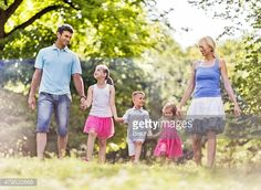 happy-family-walking-in-the-park-during-spring-day-picture-id479532666 (486×355)
