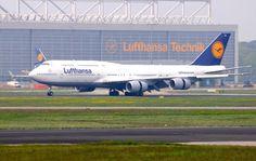 Lufthansa Boeing 747-8 in front of Lufthansa Technik maintenance facilities