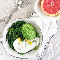 Wilted spinach, kale, Anaheim peppers topped with avocado and poached eggs