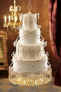 Chandelier Wedding Cakes are beautiful and elegant! #weddingcakes #cakes #chandelierweddingcakes #AnneMarieWeddingFavors