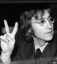 Here is an image of John Lennon putting up the 'peace sign'. This symbol has a denotative meaning of symbolizing peace | Visual Culture |