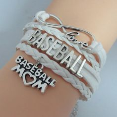 """This infinity leather and suede bracelet comes with the text """"BASEBALL"""" in the center band. It also includes a """"BASEBALL MOM"""" charm and the text """"LOVE"""" on the outer band. All proud baseball moms will"""