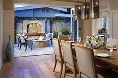 Coastal Chic: Dinner guests enjoy the soothing sounds of the customized water feature in Coronado. #BestSDHomes