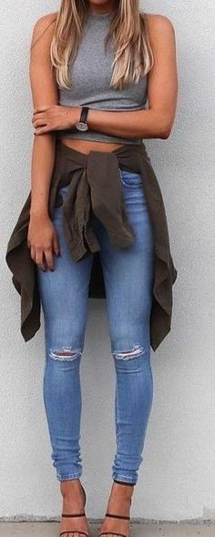 grey sleeveless crop top with jeans, heels and jacket tied around waist. #fashion #style #outfit