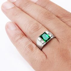 Metal: 925 Sterling Silver Emerald:  carat total weight - 3.40                   dimensions - 8mm x 10mm                   setting - Bezel setting Diamonds:  ca