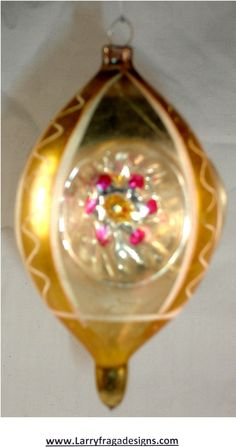 GERMAN ORNAMENT Dimensions: 4'' Description: German Victorian glass ornament. Hand painted. 3 indents.