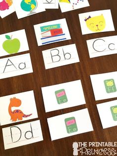 Genius! She takes alphabet posters from the Dollar Spot and turns them in to alphabet centers!