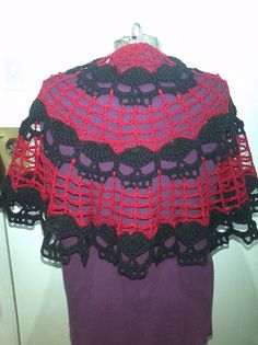 Ravelry: Project Gallery for Wikked Skulls Half Moon Shawl pattern by Spider Mambo