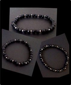 Elasticated wristband with shiny black wooden bead & silver acrylic beads spaced in-between