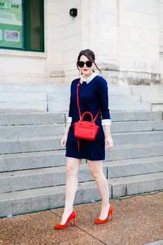 navy dress, white collar, red bag and shoes. and i want my hair to look like this every day.