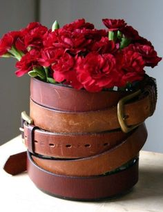 A great use for old stirrup leathers or belts is to wrap them neatly around a vase. The contrast of the rustic leather and daintily flowers is quite nice.