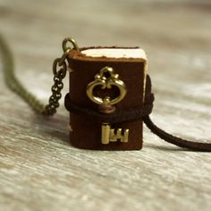 Miniature Leather Journal Necklace with Small Key Charm/Made-to-Order Book Necklace via Etsy. Unique Jewelry, Jewelry Accessories, Fashion Accessories, Jewelry Design, Gothic Jewelry, Handmade Jewellery, Book Jewelry, Jewelry Making, Book Necklace