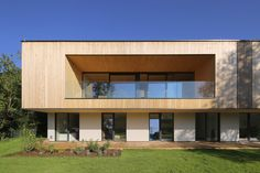 Image 1 of 28 from gallery of L House / Juri Troy Architects. Photograph by Juri Troy Vienna Woods, Wooden Facade, Construction Firm, Wooden Room, Geothermal Energy, Floor To Ceiling Windows, Wall Cladding, Architect Design, Troy