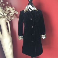 Black fake fur coat In excellent condition no flaws just don't need has animal print on collar and cuffs K.C. Collections  Jackets & Coats