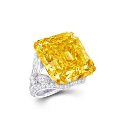 This Graff ring features one emerald-cut Fancy Vivid Yellow diamond and further white diamonds