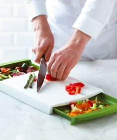 This innovative cutting board boasts two built-in drawers for collecting scraps and makes it easy to manage multiple prep jobs at once.