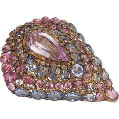 A beautiful unsigned Hobe filigree and unfoiled rhinestone fur clip. This stunning shield shape clip is set with pale sapphire, pink and pale amethyst