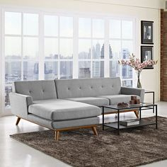Engage Left-Facing Sectional Sofa, Expectation Gray - Gently sloping curves and large dual cushions create a favorite lounging spot. Whether plopping down after a long day at work, settling in with coffee and brunch, or entering a spirited discussion with friends, the Engage Living Room Set is a welcome presence in your home. Buttons create eye catching appeal; adding depth that brings your sitting decor to center stage. Four rubber wood legs and frame supply a solid base to the comfortable…