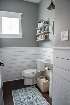 Check out this beautiful powder room reveal! This tiny bathroom was transformed . Check out this beautiful powder room reveal! This tiny bathroom was transformed from boring to fresh and modern! I love the shiplap and the modern classic decorations. Downstairs Bathroom, Bathroom Renos, Wainscoting Bathroom, Bathroom Cabinets, Bathroom Layout, Wainscoting Styles, Basement Bathroom Ideas, Bathroom Mirrors, Basement Wainscoting