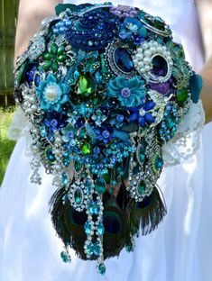 Custom Made Peacock Cascading Bridal Bouquet Peacock Feathers Cascade Teal Turquoise Blue Green Pearl Purple Purple Wedding Bouquets, Peacock Wedding, Bridal Flowers, Wedding Colors, Wedding Blue, White Bouquets, Bridesmaid Bouquets, Bling Wedding, Flower Bouquets
